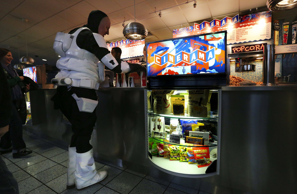 "It's thirsty work watching a ""Star Wars"" marathon, so Glenn Merkel, dressed as a Star Wars Biker Scout, gets a soda at the  Cinerama refreshment counter. (Alan Berner / The Seattle Times)"