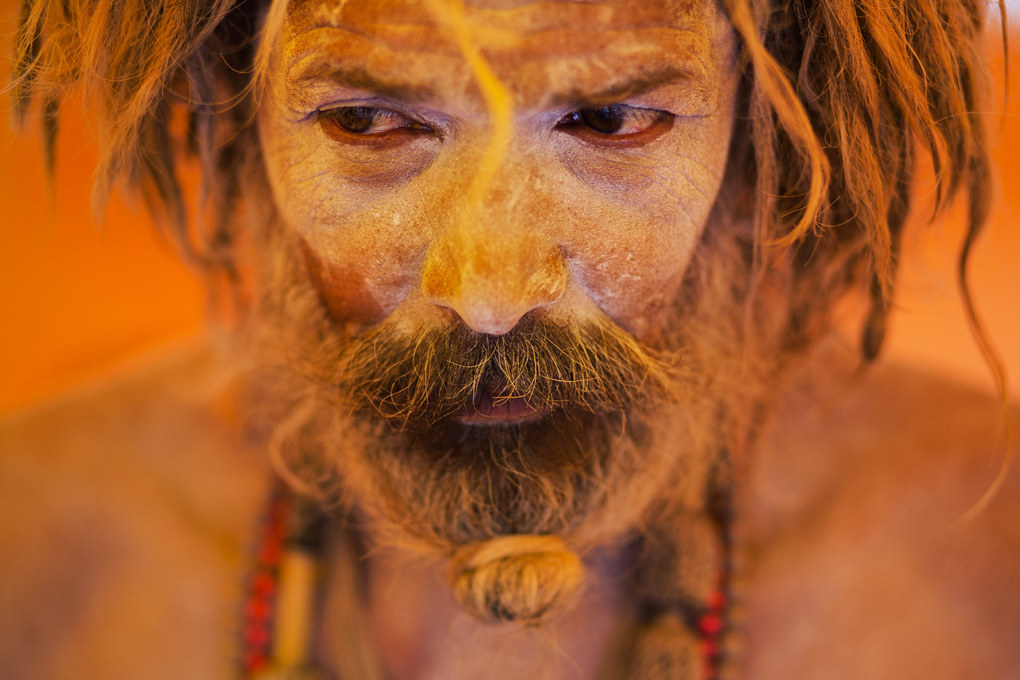 In this Aug. 27, 2015 photo, Naga sadhu, or naked Hindu holy man, pauses inside a tent during Kumbh Mela, or Pitcher festival, at Trimbakeshwar, India. Hindus believe taking a dip in the waters of a holy river during the festival will cleanse them of their sins. The festival is held four times every 12 years. (AP Photo/Bernat Armangue, File)
