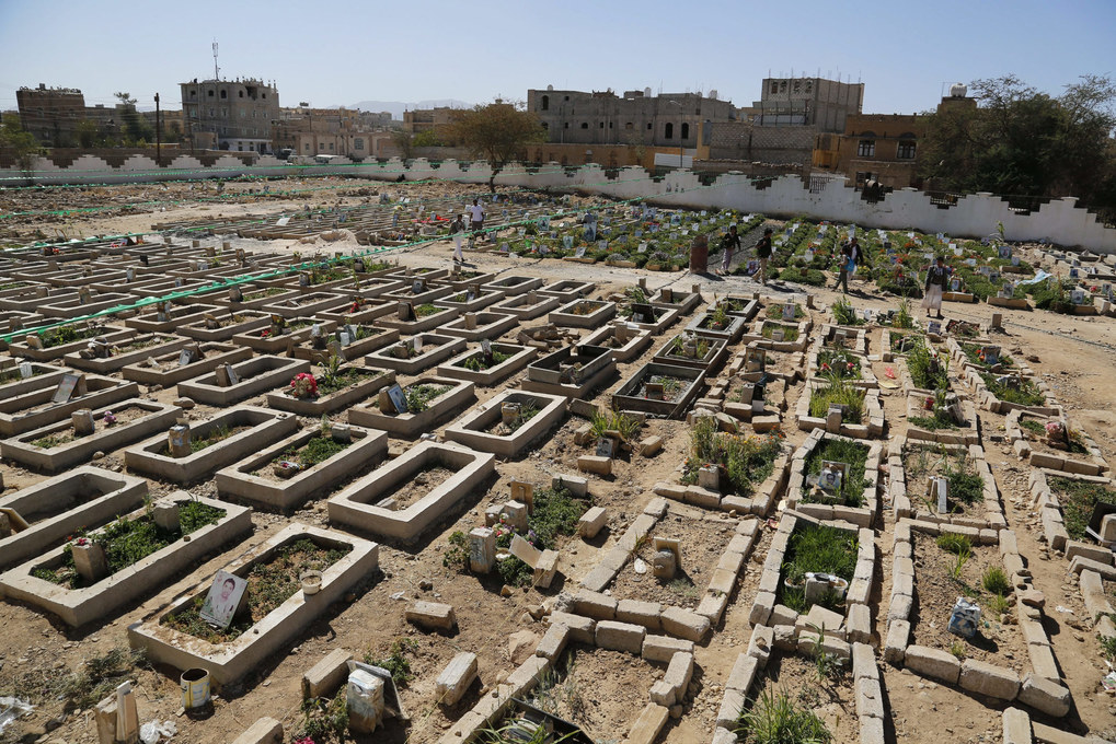 Members of the Houthi militia walk amongst the graves of their comrades killed as they were fighting alleged Saudi-led coalition backed forces, in a cemetery in Sana'a, Yemen, December 21, 2015. Talks between representatives of Abdo Rabbo Mansour Hadi and the Houthis which began 15 December, amid a temporary truce that was frequently broken by all sides, including the Saudi-led coalition that has been backing Hadi, ended inconclusively, though attendees pledged to meet again in January. Ongoing fighting in Yemen has led to the deaths of thousands of civilians, and left millions desperately in need of humanitarian assistance.  EPA/YAHYA ARHAB