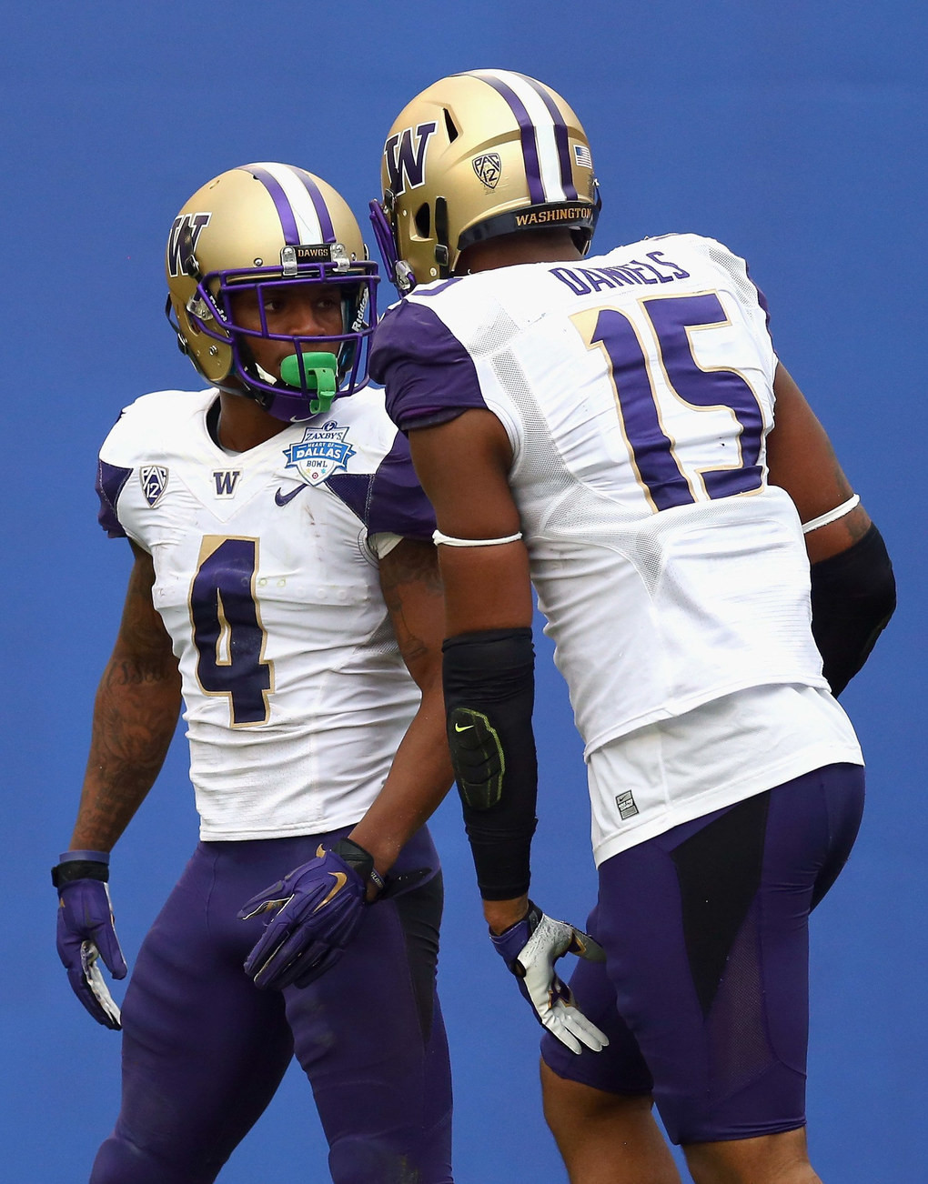 Jaydon Mickens#4 of the Washington Huskies celebrates his touchdown with Darrell Daniels #15 against the Southern Miss Golden Eagles during the Zaxby's Heart of Dallas Bowl at Cotton Bowl on December 26, 2015 in Dallas, Texas.  (Photo by Ronald Martinez/Getty Images)