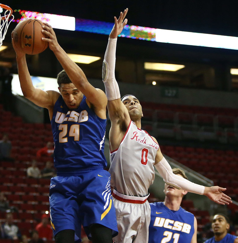 UCSB's Michael Bryson (24) retrieves a rebound before Seattle University's Brendan Westendorf (0).  (Sy Bean / The Seattle Times)