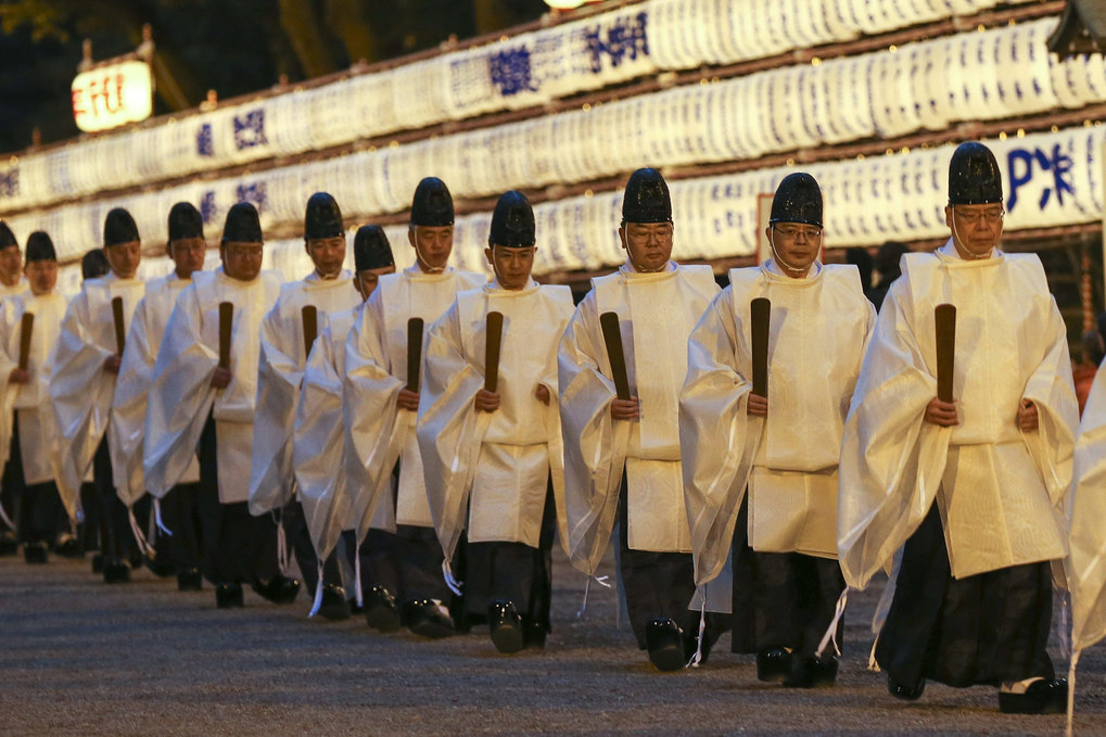Shinto priests leave the shrine's main sanctuary at Meiji Shrine in Tokyo, Japan, December 31, 2015, to attend the shinto ritual preparing for the New Year. More than three million people visit the Meiji Shrine during the first three days of the New Year, to pray for their health, economic fortune and wishes to come true.  EPA/KIMIMASA MAYAMA