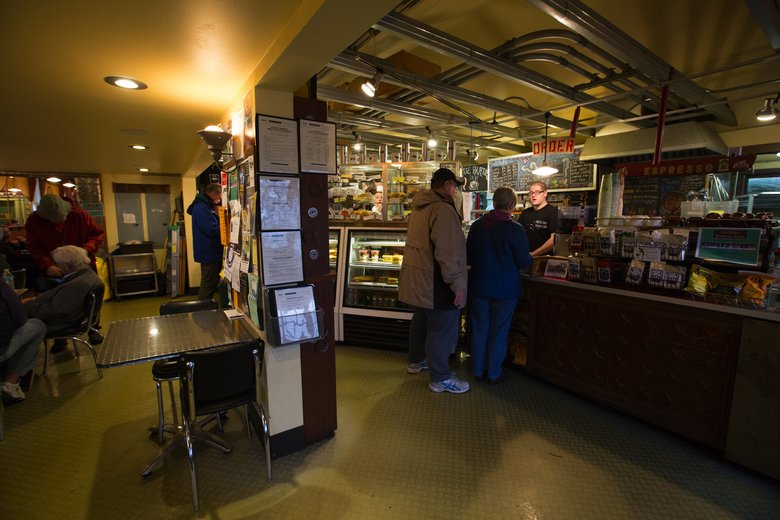 Niles McDonald waits on customers at Useless Bay Coffee Co., which is photogenic inside and out. It is located at 121 Second St., Langley.  (Ellen M. Banner/The Seattle Times)