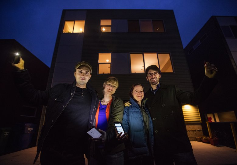 """From left, Andy Greenlee, Lindsay Andersen, Margo Arnold and James Sutter bought a new, three-bedroom house together in Seattle's Columbia City area for $705,000. """"Coming home to your best friends every night — that's what drives us. The economics are just a bonus,"""" Sutter said. (Steve Ringman/The Seattle Times)"""