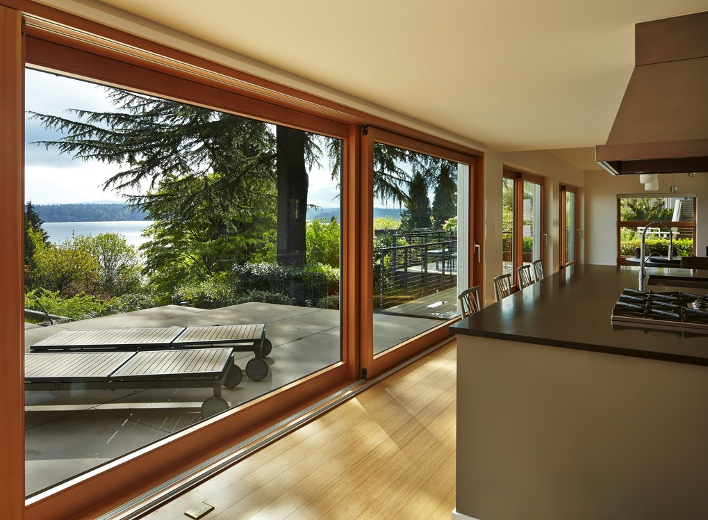 The couple searched hard for a large view lot within Seattle before finding this spot in the Mount Baker neighborhood. The kitchen, living and dining rooms open wide to connect to the yard and lake.  (Benjamin Benschneider/The Seattle Times)