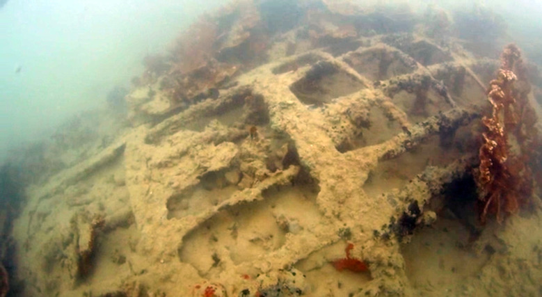 In this June 12, 2015 image taken from video provided by NOAA, a U.S. Navy seaplane that sank in Hawaii waters during the Japanese attack on Pearl Harbor is shown. New images of the plane are the clearest taken of the Catalina PBY-5 to date, Hans Van Tilburg, a maritime archaeologist with the Office of National Marine Sanctuaries, says. (NOAA Office of National Marine Sanctuaries via AP)