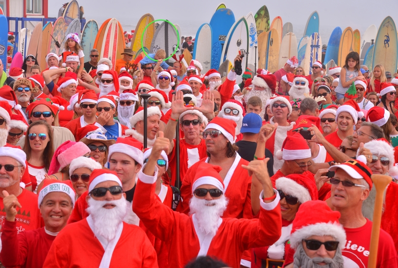 Surfing Santas as far as you could see. More than 6000 people showed up to watch hundreds of surfing Santa's take to the waves in Cocoa Beach, Fla., Thursday, Dec. 24, 2015,  at the end of Minutemen Causeway for the 7th Surfing Santas of Cocoa Beach.  The event raises money for Grind for Life. The event has grown since George Trosset and his son George and daughter-in-law Britteny went surfing in Santa, snowman and  elf costumes seven years ago in 2009. (Malcolm Denemark/Florida Today via AP)