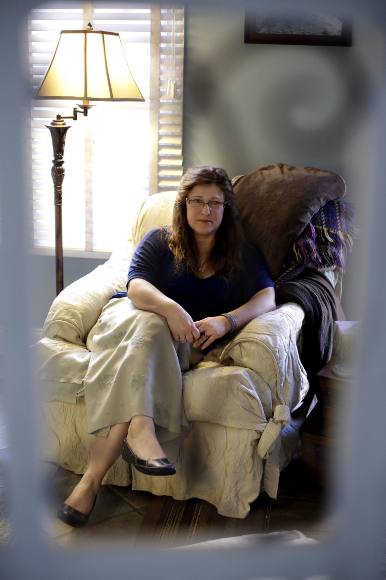 In this Friday, Dec. 18, 2015, photo, Willa Wertheimer, a psychologist, poses for a photo in her office in Crystal Lake, Ill. By taking Wertheimer's DNA and having it tested, Cook County Sheriff's Detective Jason Moran was recently able to identify her half-brother, Andre Drath, who'd been murdered 36 years earlier in San Francisco. (AP Photo/Nam Y. Huh)