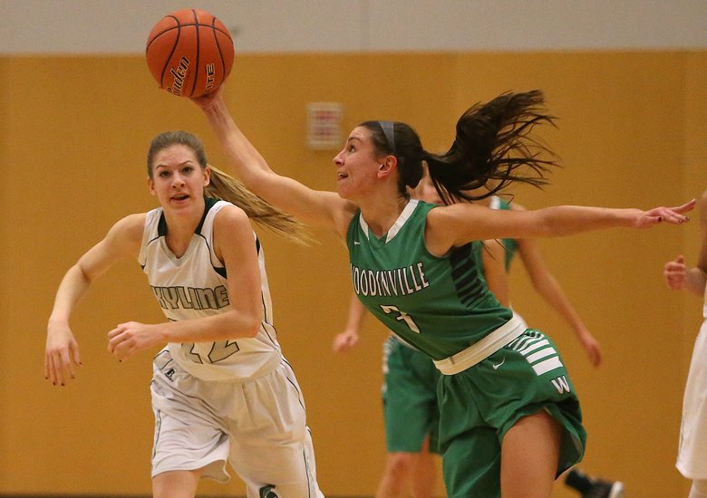Woodinville's Emily Spencer (3) intercepts a pass and keeps it away from Skyline's Maddie Adamson (22).  (Sy Bean/The Seattle Times)
