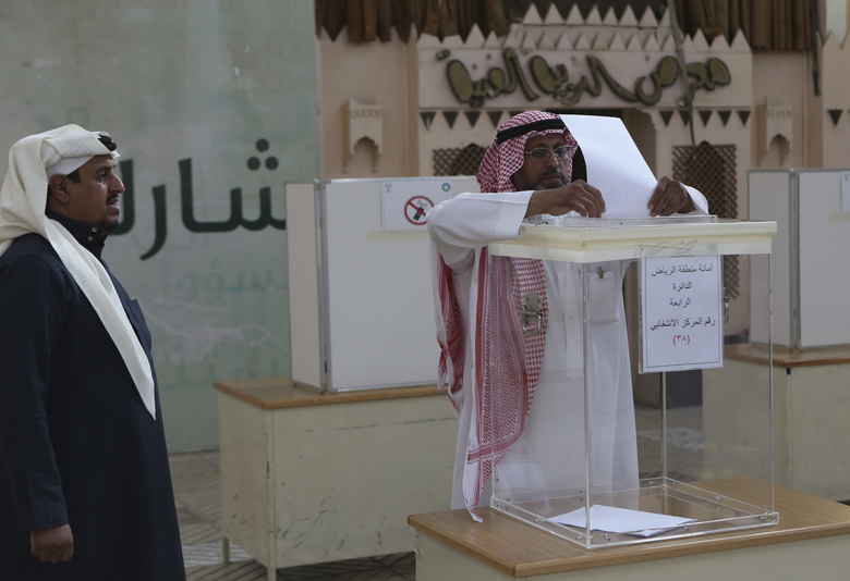 A Saudi man casts his vote at a polling center during the country's municipal elections in Riyadh, Saudi Arabia, Saturday, Dec. 12, 2015. (AP Photo/Khalid Mohammed)