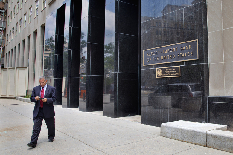 FILE – In this July 28, 2015, file photo, a man walks out of the Export-Import Bank of the U.S. in Washington. (AP Photo/Jacquelyn Martin, File)