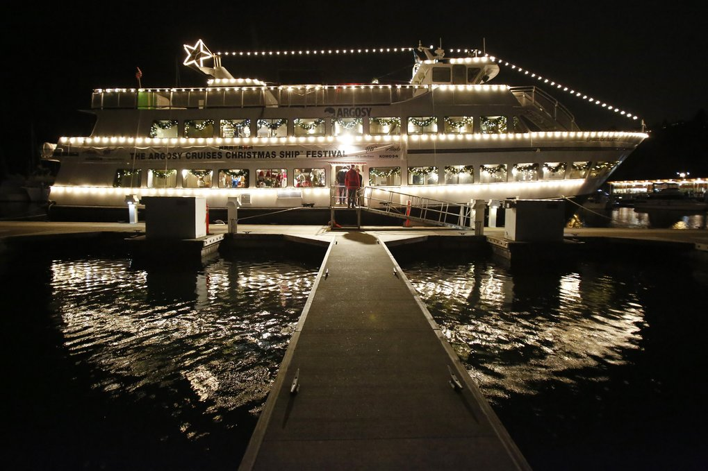 An Argosy Cruises ship decorated with holiday lights waits at Seattle's Shilshole Bay Marina for guests