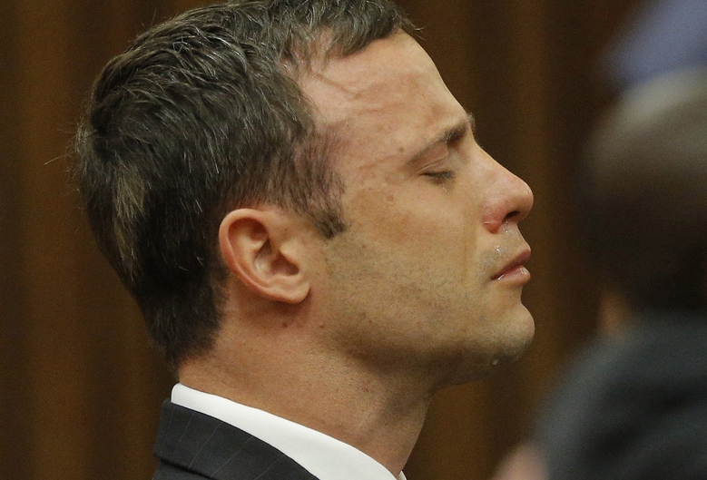 CORRECTS TO THURSDAY – FILE – In this Thursday Sept. 11, 2015 file photo, Oscar Pistorius reacts in the dock as Judge Thokozile Masipa delivers her verdict during his murder trial in Pretoria, South Africa.  The appeals court in Bloemfontein, South Africa, Thursday, Dec. 3 2015, convicted Pistorius of murder, overturning a lower court's conviction of the double-amputee Olympian on the lesser charge of manslaughter for shooting his girlfriend to death in 2013. (AP Photo/Kim Ludbrook, File, Pool)