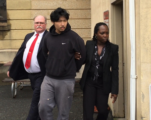 Nassau County Detectives lead Oliver Lee out of Nassau County Police Headquarters in Mineola, N.Y., Wednesday, Dec. 23, 2015. Lee was arrested on Tuesday, Dec. 22, after security personnel wrestled him to the ground as he tried to rob a jewelry store in the Roosevelt Field Mall in Garden City, N.Y. During the scuffle his firearm discharged and seriously wounded a mall employee. (AP Photo/Michael Balsamo)