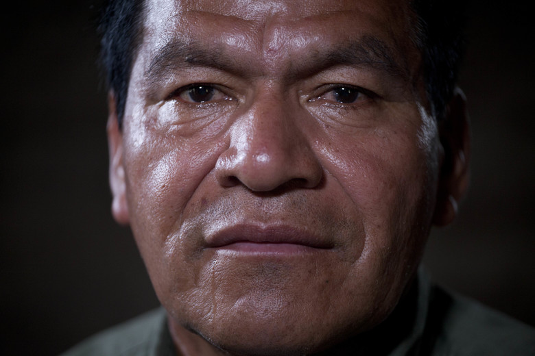In this Dec. 11, 2015 photo, Juan Chen Chen, a survivor of the Rio Negro massacre, poses for photos after giving his testimony to the Guatemalan Forensic Anthropology Foundation FAFG in Rabinal, Guatemala. FAFG and The USC Shoah Foundation, founded by director Steven Spielberg, are collecting hundreds of oral histories in Guatemala, in what would be the most comprehensive effort to document testimonies by survivors and witnesses from the Central American nation's genocide. (AP Photo/Moises Castillo)