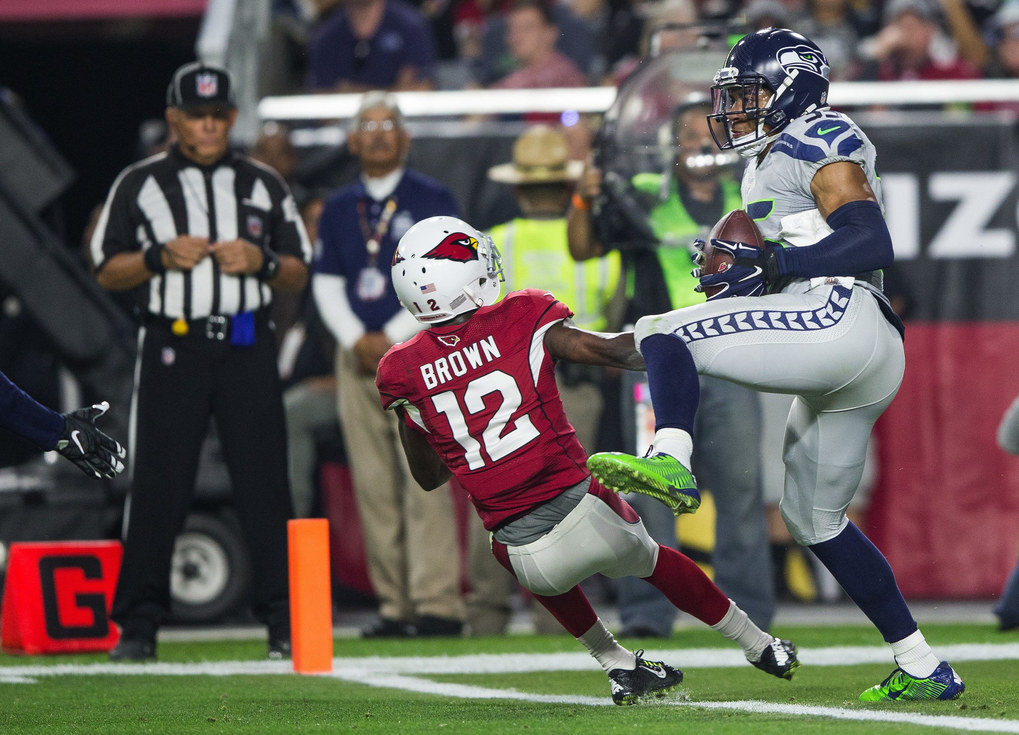 DeShawn Shead intercepts the pass intended for John Brown at the goal line in the fourth quarter. (Dean Rutz / The Seattle Times)