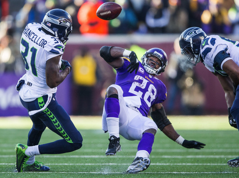 Minnesota Vikings running back Adrian Peterson fumbles the ball in the fourth quarter. The Seahawks recovered the ball. (Dean Rutz / The Seattle Times)