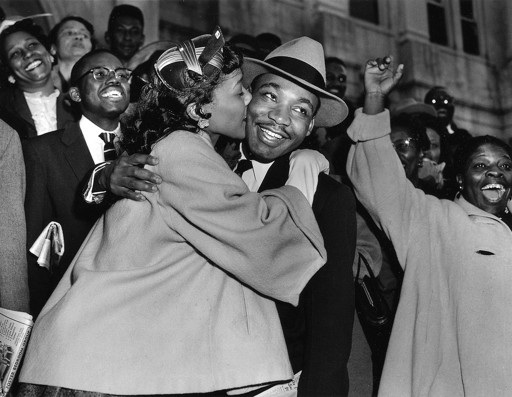 The Rev. Martin Luther King Jr. is welcomed with a kiss by his wife Coretta after leaving court in Montgomery, Ala., March 22, 1956. King was found guilty of conspiracy to boycott city buses in a campaign to desegregate the bus system, but a judge suspended his $500 fine pending appeal.  (Gene Herrick / The Associated Press