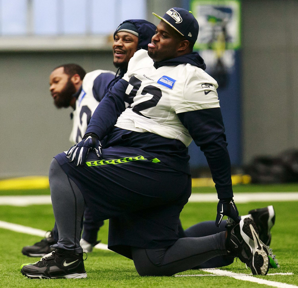 Seattle Seahawks' Michael Bennett, from left, Marshawn Lynch and Brandon Mebane stretch during practice.  (Erika Schultz / The Seattle Times)