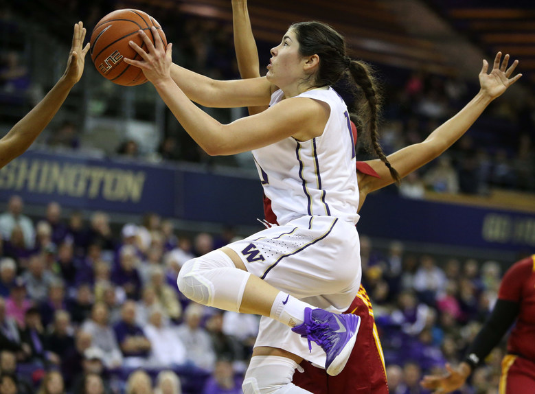 UW guard Kelsey Plum drives her way to the basket. (Ken Lambert / The Seattle Times)