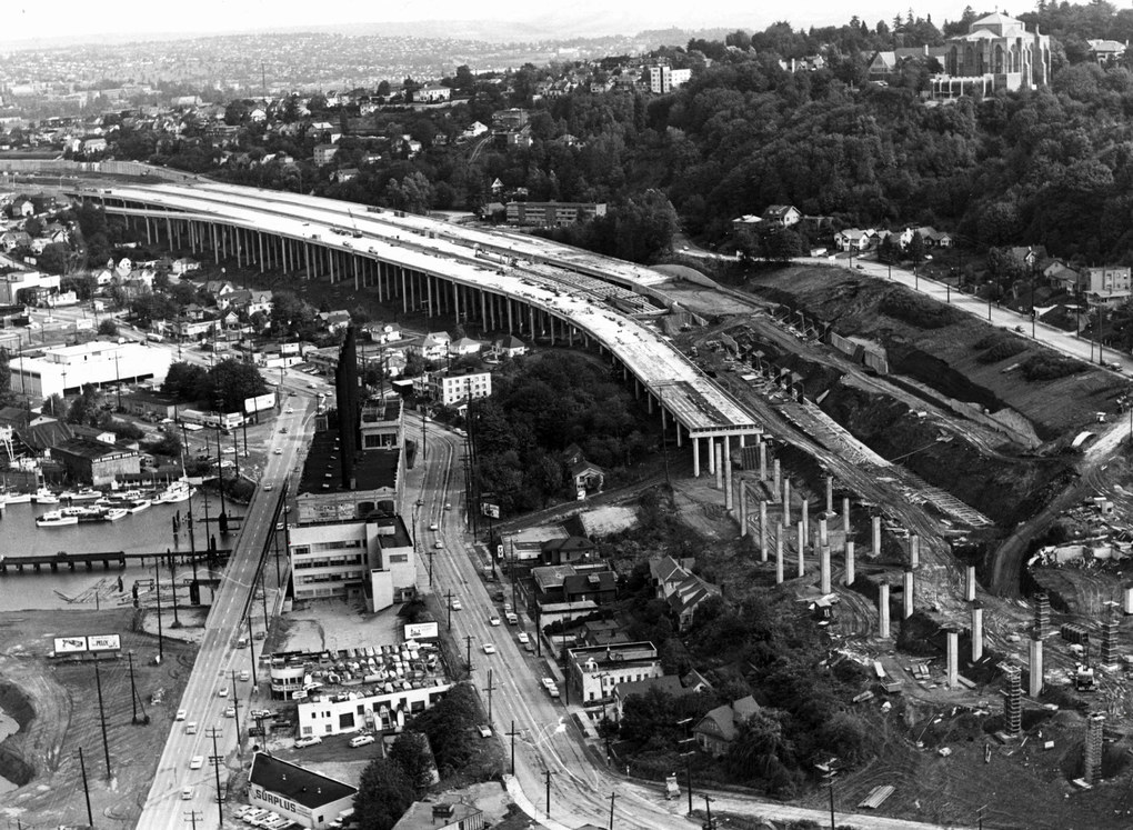 This aerial photograph shows progress of construction work on elevated portions of the freeway east of Lake Union on Oct. 1, 1962.  On the hill at right is St. Mark's Cathedral. (Paul V. Thomas / The Seattle Times)