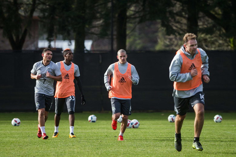 From left, Cristian Roldan, Joevin Jones, Osvaldo Alonso and Chad Marshall work out at Seattle Sounders Training Camp at Starfire Sports Complex in Tukwila, Washington, Monday January 25, 2016.  (Bettina Hansen / The Seattle Times)