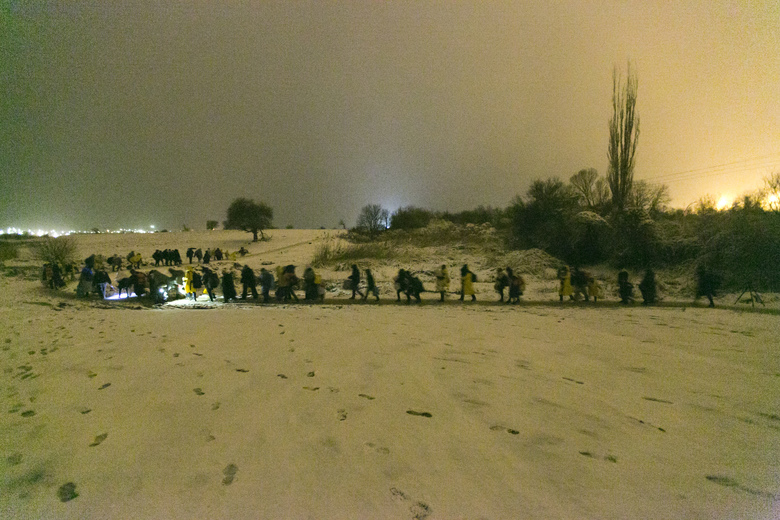 Migrants walk through snow storm from the Macedonian border into Serbia, near the village of Miratovac, Serbia, early morning on Sunday, Jan. 17, 2016. Bracing cold temperatures and snow storms hundreds of migrants continue to arrive daily into Serbia in order to register and continue their journey further north towards Western Europe. (AP Photo/Visar Kryeziu)