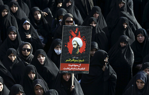 An Iranian woman holds up a poster showing Sheikh Nimr al-Nimr, a prominent opposition Saudi Shiite cleric who was executed last week by Saudi Arabia, in Tehran, Iran, Monday, Jan. 4, 2016. Allies of Saudi Arabia followed the kingdom's lead and began scaling back diplomatic ties to Iran on Monday after the ransacking of Saudi diplomatic missions in the Islamic Republic, violence sparked by the Saudi execution of al-Nimr. (AP Photo/Vahid Salemi)