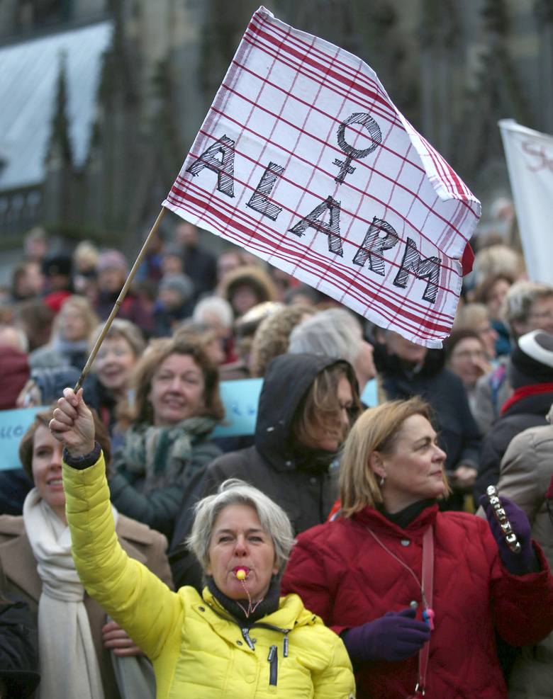 Demonstrators protest  against racism and sexism in the wake of the sexual assaults on New Year's Eve, in Cologne, Germany,  Saturday Jan. 9,  2016.  After the sexual assaults around Cologne's main station on New Year's Eve, various groups have called for demonstrations on Saturday.  (Oliver Berg/dpa via AP)