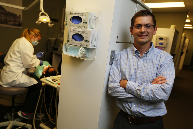Dr. Morgan Ball, the dentist who treated Fecteau, says that for a cleaning that typically costs more than $100, the state reimburses only $24. (Ken Lambert/The Seattle Times)