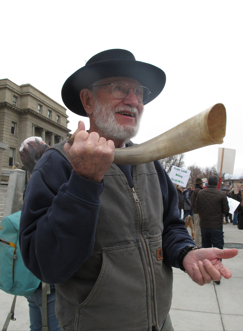 Gene Bray shows off his bullhorn in front the Statehouse during a protest against the recent occupation of the Malheur National Wildlife Refuge in southeastern Oregon by group of armed activists, Tuesday, Jan. 19, 2016, in Boise, Idaho.  More than 100 protesters, including environmentalists, bird watchers and sportsmen gathered calling for the arrest and prosecution for taking over public land. (AP Photo/Kimberlee Kruesi)