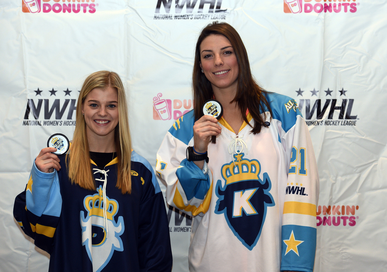 In this Saturday, Jan. 23, 2016, photo, National Women's Hockey League All-Star captains Hilary Knight, left, and Emily Pfalzer pose holding game pucks in Buffalo, N.Y. In just its first year, the upstart U.S.-based NWHL beat it's longer-established, Canadian-based counterpart to the punch by paying its players this season. Now the five-team Canadian Women's Hockey League is vowing to start paying its players. The question now is whether two competing leagues are sustainable, with players and officials on both sides of the border suggesting that a merger might be best in the long run. (AP Photo/Gary Wiepert)