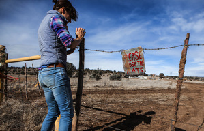 Laura Jean Schneider closes the barbed-wire gate to Cow Camp 2, where she and her husband, Sam Ryerson live in a 320 square-foot fifth-wheel camper, on January 15 in Mescalero, N.M. The couple manage the Triangle P Cattle Company, which has five partners in New Mexico and Texas. MUST CREDIT: Photo by Mark Holm for The Washington Post