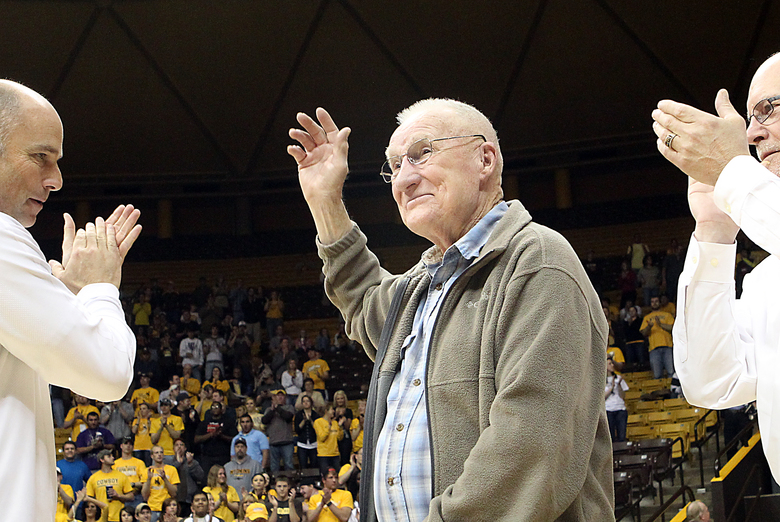 FILE – In this March 14, 2012, file photo, former Wyoming basketball star Kenny Sailors waves to the crowd during a ceremony  in Laramie, Wyo.,  honoring his election into the National Collegiate Basketball Hall of Fame. Sailors, a College basketball Hall of Famer and the man credited by some with being the first to use the modern jump shot, died in his sleep early Saturday, Jan. 30, 2016, at an assisted living center in Laramie, Wyo., the University of Wyoming announced. He was 95.   (Michael Smith/The Wyoming Tribune Eagle via AP) MANDATORY CREDIT