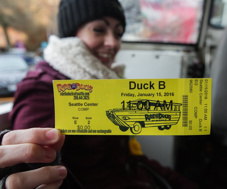 Katy Whitley, of Seattle, shows off her ticket for Ride the Ducks, the first day of the tour's return after a fatal crash four months ago.  (Steve Ringman/The Seattle Times)