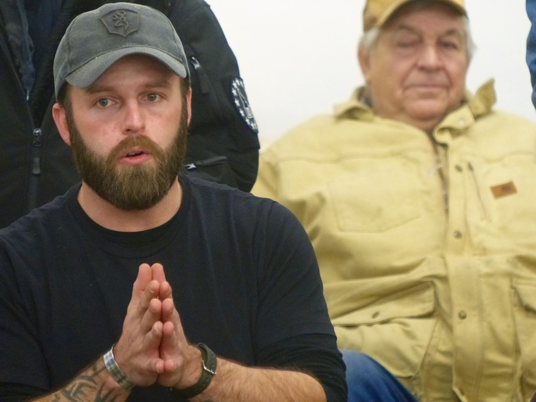 Ryan Payne, an Army veteran from Montana, speaks at a community meeting in Burns on Friday. He was among militia members who seized control of the Malheur National Wildlife Refuge. (Les Zaitz/The Oregonian via AP)