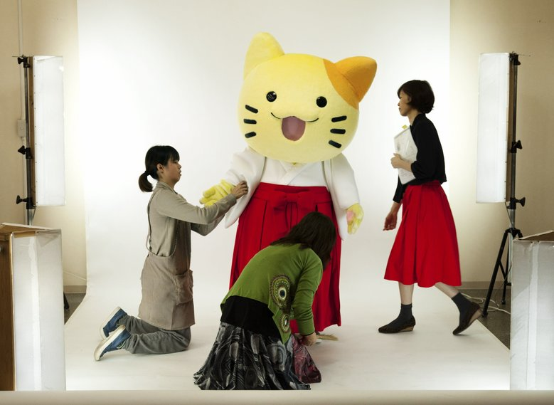 Workers tend to a mascot before a photo shoot at the Kigurumi.biz factory in Miyazaki, Japan. Its suits, which cost $4,000 to $6,500, are the Cadillacs of the mascot world. (KO SASAKI/NYT)