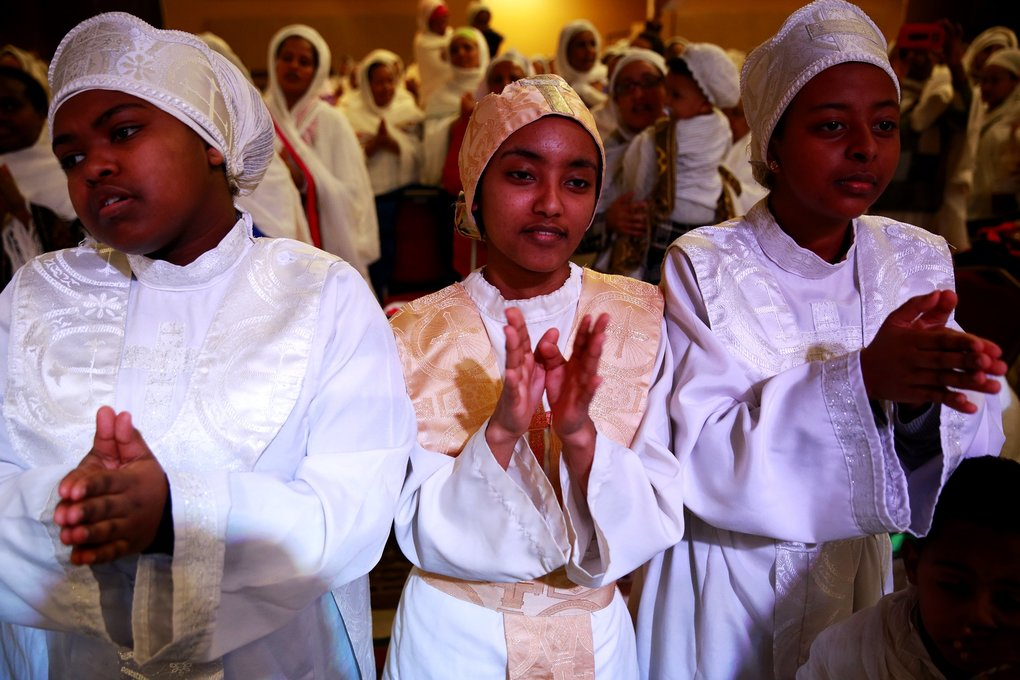 Sosina Tadesse, center, worships during Timket services. (Erika Schultz/The Seattle Times)