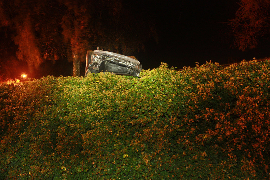 The in this photo by the Bellevue Police Department, shot in the evening of Oct. 14, 2015, the other vehicle involved in the collision rests above the road. Derrick Coleman's truck lays on the side of the road below.