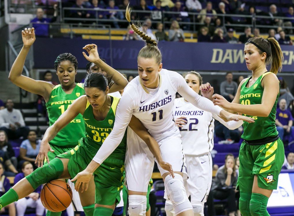 Washington forward/center Mathilde Gilling loses an offensive rebound to Oregon guard Lexi Petersen in the fourth quarter. (Bettina Hansen / The Seattle Times)
