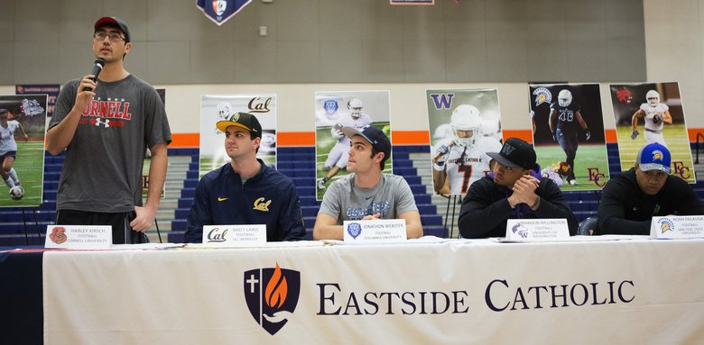 Quarterback Harley Kirsch speaks briefly on National Signing Day in the Eastside Catholic gym in Sammamish on Wednesday, Feb. 3. Ten athletes from Eastside Catholic participated in the Signing Day ceremony, including University of Washington commit Brandon Wellington. (Lindsey Wasson/The Seattle Times)