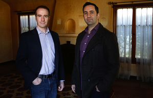 Jason Fritton, CEO of the crowdfunding platform Patch of Land, left, and David Berneman of Golden Bee Properties in one of the homes they plan to renovate. (Katie Falkenberg/Los Angeles Times/TNS)