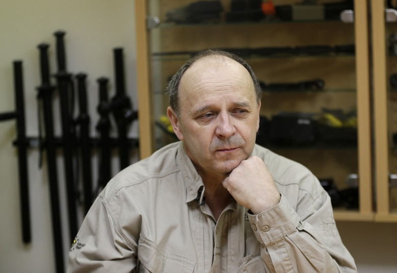 In this picture taken on Monday, Jan. 25, 2016, owner of Euro Security Products, a self defense equipment company, Bretislav Kostal displays listens during an interview in Prague, Czech Republic. After the attacks in Paris and New Year's security scares, Germans have been snapping up self-defense equipment like stun guns _ to the delight of a Czech manufacturer who corners the market. Prague-based Euro Security Products, or ESP, has been flooded by new orders from Germany for stun guns and can't keep up with demand. (AP Photo/Petr David Josek)