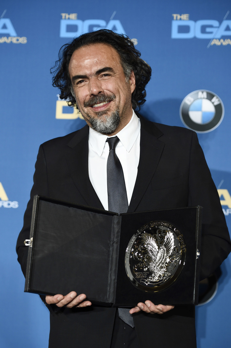 "Director Alejandro Gonzalez Inarritu, a feature film award nominee for ""The Revenant,"" poses with his nomination medallion at the 68th Directors Guild of America Awards at the Hyatt Regency Century Plaza on Saturday, Feb. 6, 2016 in Los Angeles. (Photo by Chris Pizzello/Invision/AP)"