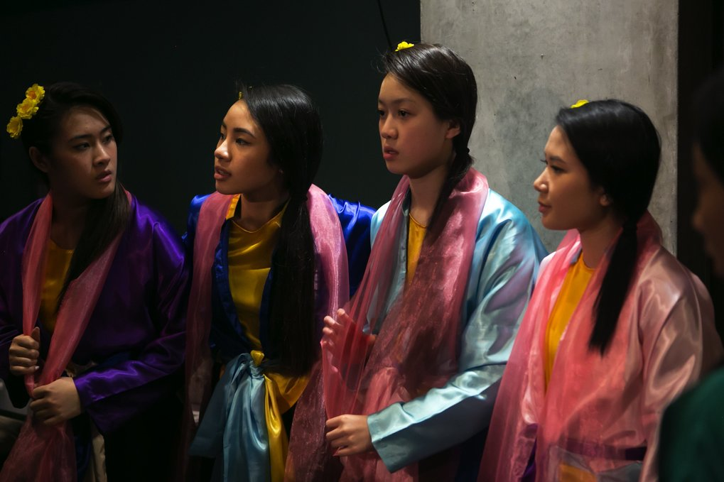 Dancers from the GDPT Lieu Quan Buddhist youth group get ready to take the stage for the celebration. (Bettina Hansen/The Seattle Times)