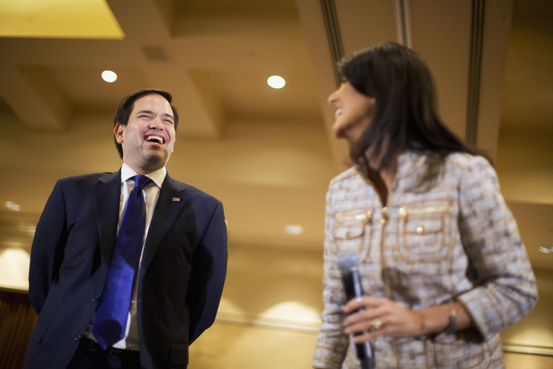 Republican presidential candidate, Sen. Marco Rubio, R-Fla. laughs while waiting to be introduced by South Carolina Gov. Nikki Haley at a campaign event at the InterContinental Hotel, Monday, Feb. 29, 2016, in Atlanta. (AP Photo/David Goldman)