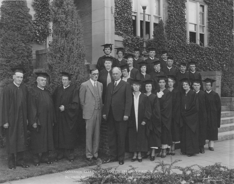 The only known photograph of Gov. Clarence Martin, center left, and Western President Charles Fisher, center right, together, includes the graduating class of 1933 in front of the central campus building now known as Old Main. Martin would force Fisher from office five years later by threatening to replace college trustees who had supported the school's popular fourth president. (Courtesy WWU Campus History Collection)