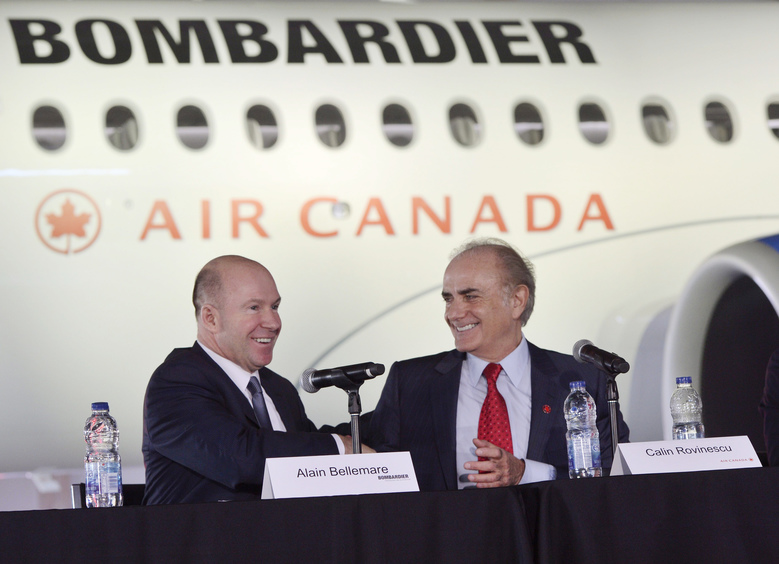 Alain Bellemare, left, president and Chief Executive Officer, Bombardier Inc., shakes hands with Calin Rovinescu, president and Chief Executive Officer of Air Canada, at a news conference in Montreal, Wednesday, Feb. 17, 2016. Bombardier has a deal to sell Air Canada 45 CSeries jets, with an option to buy up to 30 more. Bombardier also announced Wednesday it will eliminate 7,000 positions, or about 10 percent of its global workforce, over two years. (Paul Chiasson/The Canadian Press via AP) MANDATORY CREDIT