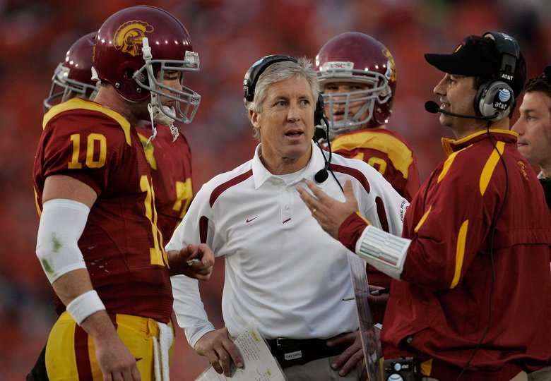 In this 2008 photo, USC coach Pete Carroll, center, looks on as offensive coordinator Steve Sarkisian talks with quarterback John David Booty during the Rose Bowl in Pasadena, Calif.  (Jeff Gross/Getty Images)
