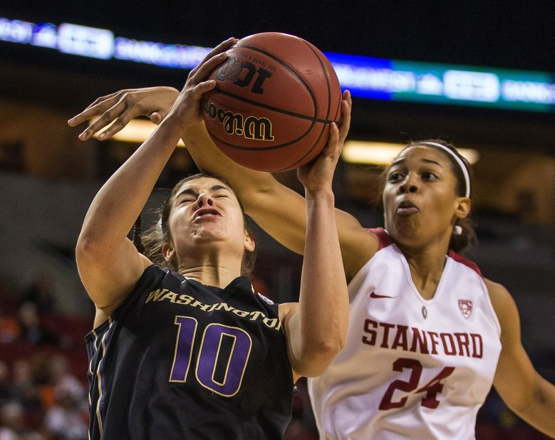 Kelsey Plum is fouled by Stanford's Erica McCall in the 2nd half.  (Dean Rutz / The Seattle Times)